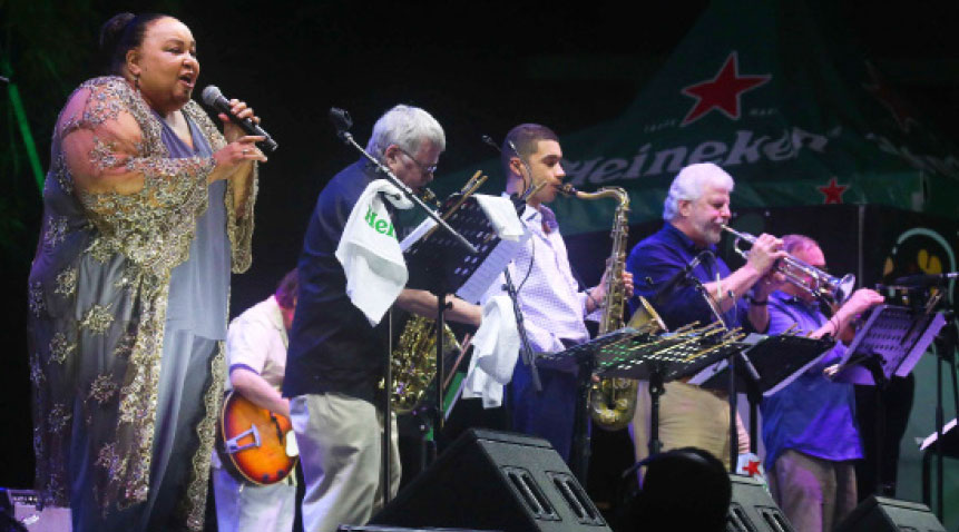 Singer Donna McElroy joined by a horn section at the Heineken Jazz Fest.
