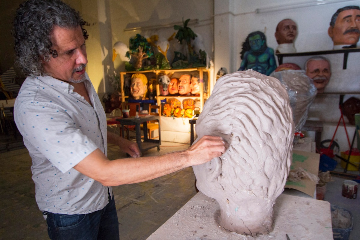 Pedro Adorno, director of Agua Sol y Sereno, designs cabezudos, gigantones, and giant masks by using mache techniques.