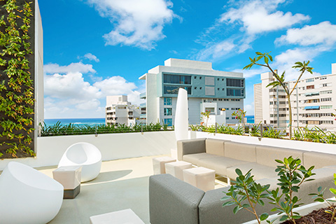 Rooftop lounge at AC Hotel San Juan features a swimming pool and one-of-a-kind views of the bustling Condado district.