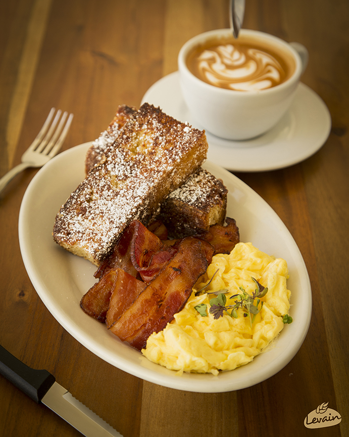 Debut Cocina Rustica's homemade brioche bread French toast with a side of eggs and bacon.