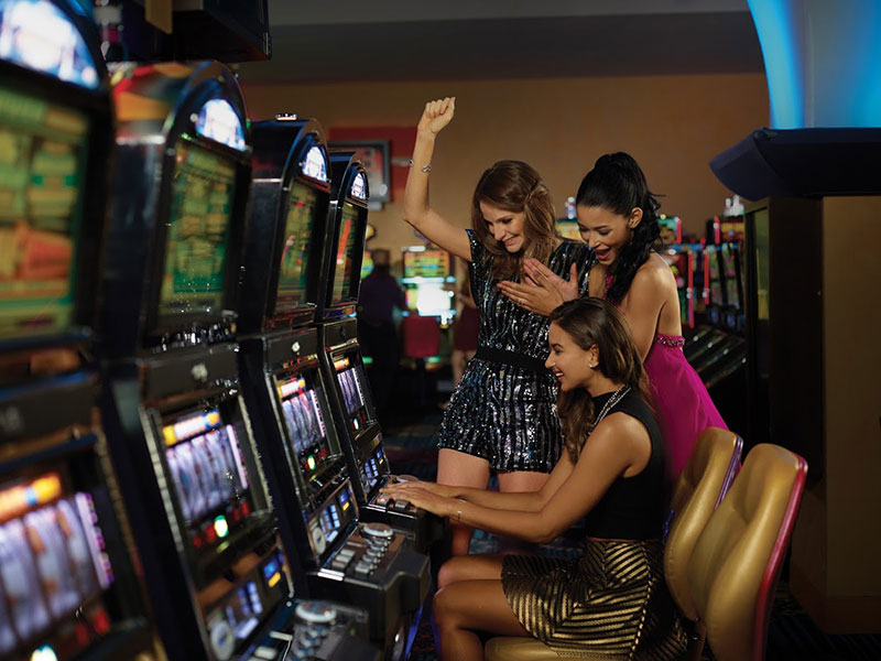 Girls playing with slot machines at Casino Metro