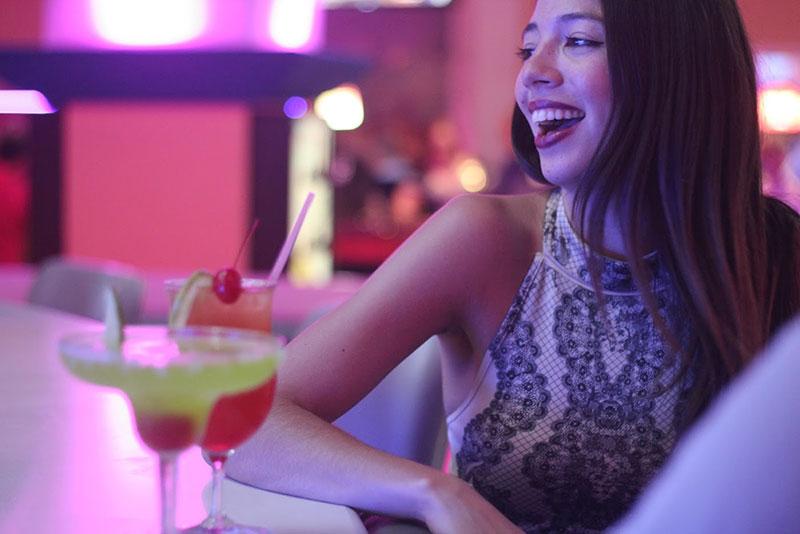 Girl at bar in Casino Metro
