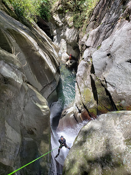 Jose Jochi Mendez, founder of Canyoning Puerto Rico, is descending the waterfall of Rio Prieto in Ponce.