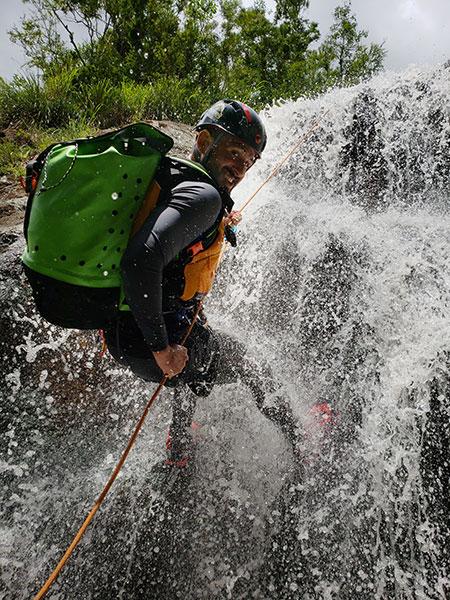 Gustavo Martinez-Cañavate descending La Plazuela waterfall in Orocovis.