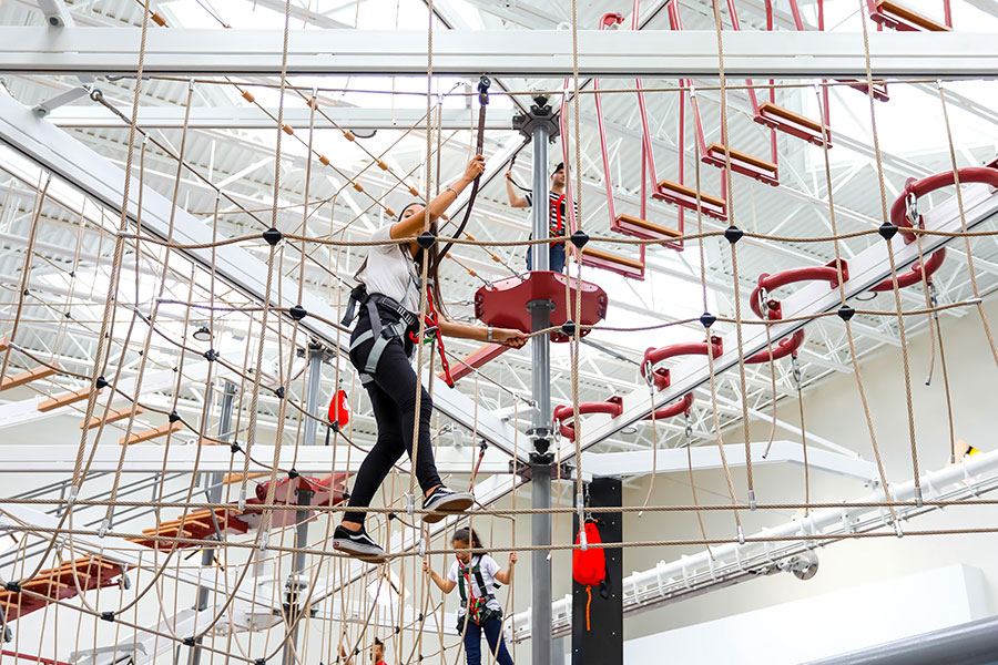 Visitors can make their way through different obstacles, and enjoy the thrill of zip lining while shoppers watch.