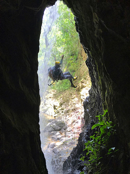 Jose Jochi Mendez of Canyoning Puerto Rico finishing up his rapelling at Las Bocas Canyon in Barranquitas.