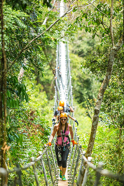 The thrill-seeking group can soar 1,200 feet high through the lush mountains at Toro Verde Adventure Park in Orocovis.